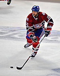 22 April 2009: Montreal Canadiens' defenseman Mathieu Dandenault looks to pass up ice during the first period against the Boston Bruins at the Bell Centre in Montreal, Quebec, Canada. The Bruins advanced to the Eastern Semi-Finals, eliminating the Canadiens from Stanley Cup competition with a 4-1 win and series sweep. ***** Editorial Sales Only ***** Mandatory Credit: Ed Wolfstein Photo