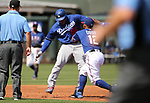 Texas Rangers' Rougned Odor makes the tag after Los Angeles Dodgers' Yasiel Puig gets caught in a pickle during spring training game in Surprise, Ariz., on Saturday, March 26, 2017.<br /> Photo by Cathleen Allison/Nevada Photo Source