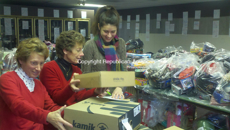 SOUTHBURY, CT. - 15 Dec. 2011 - 121511CG01 - Volunteers, from left, Helen Sargent, Mary Ann Kendall and Katie Baczeski organize boxes of boots Thursday for the Southbury Needy Fund toy and clothing drive. The needy fund collected thousands of donations which will be distributed this weekend to 90 families in Southbury. Chris Gardner Republican-American