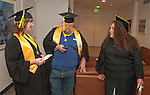 Brittany Esposito, left, Steve Vaughn and Rebecca Benner talk about future plans at the Western Nevada College commencement in Fallon, Nev., on Tuesday, May 20, 2014. <br /> Photo by Kim Lamb