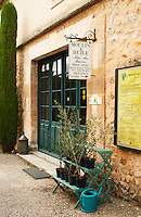 The entrance to the olive oil shop. with sign and small olive tree plants. Moulin Mas des Barres olive mill, Maussanes les Alpilles, Bouches du Rhone, Provence, France, Europe