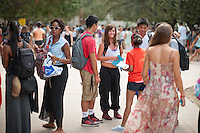 From left, Tyler Berkeley Brewington '14, Mike Ma '16, Cassie Shultz '16, Kevin Liu '16 and Shaila Ramachandran '15.<br /> Occidental College students get involved at the annual Involvement Fair (formerly Club Day) on Tuesday, September 11, 2012 in the Academic Quad. About 120 organizations set up shop with mailing list sign up sheets, fliers for upcoming events and information about ways to get involved with their department or organization. (Photo by Marc Campos, Occidental College Photographer)