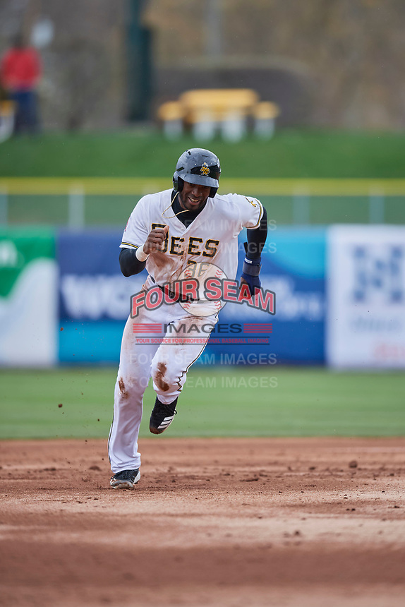 Jabari Blash (36) of the Salt Lake Bees heads to third base during the game against the Albuquerque Isotopes at Smith's Ballpark on April 8, 2018 in Salt Lake City, Utah. Albuquerque defeated Salt Lake 11-4. (Stephen Smith/Four Seam Images)