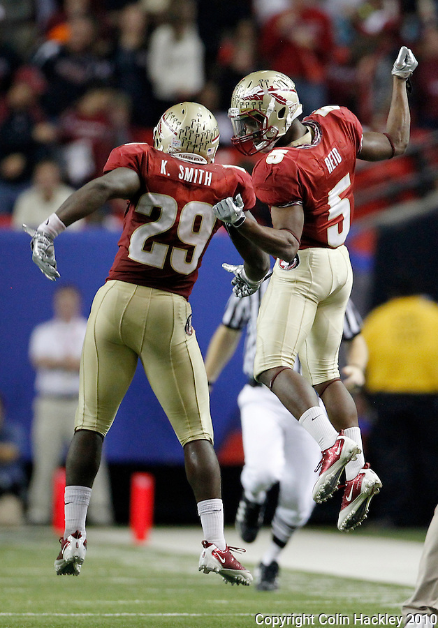 ATLANTA, AG 12/31/10-FSU-SC FB10 CH-Florida State's Greg Reid, right, celebrates with Kendall Smith after Reid broke up a South Carolina pass late in the fourth quarter Friday at the Chick-fil-A Bowl in Atlanta. The Seminoles beat the Gamecocks 26-17..COLIN HACKLEY PHOTO