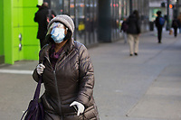 NEW YORK, NY - MARCH 24: A woman wears a face mask due to the increase in Coronavirus on March 24, 2020 in New York City. New York City, with more than 25,000 confirmed cases of (COVID-19), makes it the epicenter of the outbreak in the United States. (Photo by Pablo Monsalve / VIEWpress via Getty Images)