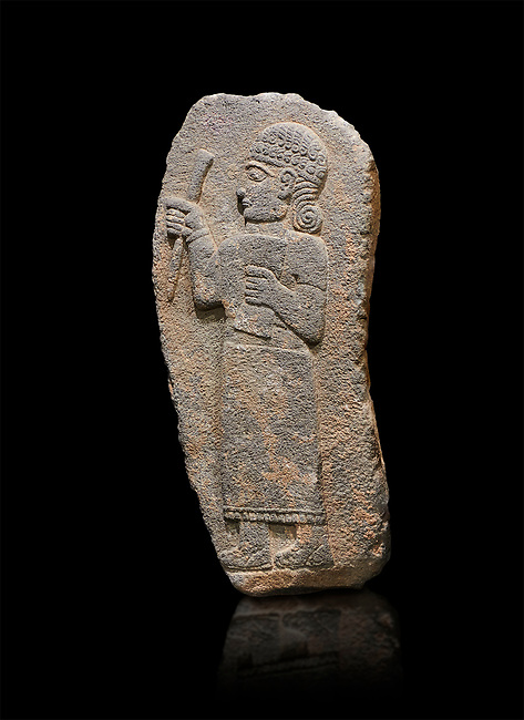 Hittite monumental relief sculpture of a figure holding a document. Adana Archaeology Museum, Turkey. Against a black background