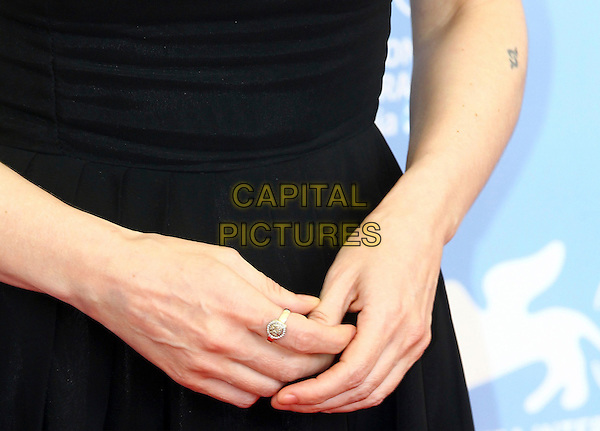 Winona Ryder's hands.Photocall for 'The Iceman' at the 69th International Venice Film Festival, Venice, Italy..August 30th, 2012.hands detail jewellery jewelry ring tattoo.CAP/PPG/WS.©Willi Schneider/People Picture/Capital Pictures