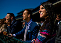 LEXINGTON, KENTUCKY - APRIL 07: A woman smiles while watching horses on the track on opening day at Keeneland Race Course on April 7, 2017 in Lexington, Kentucky. (Photo by Scott Serio/Eclipse Sportswire/Getty Images)