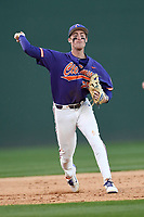Third baseman Patrick Cromwell (25) of the Clemson Tigers throws out a baserunner in the Reedy River Rivalry game against the South Carolina Gamecocks on Saturday, March 3, 2018, at Fluor Field at the West End in Greenville, South Carolina. Clemson won, 5-1. (Tom Priddy/Four Seam Images)