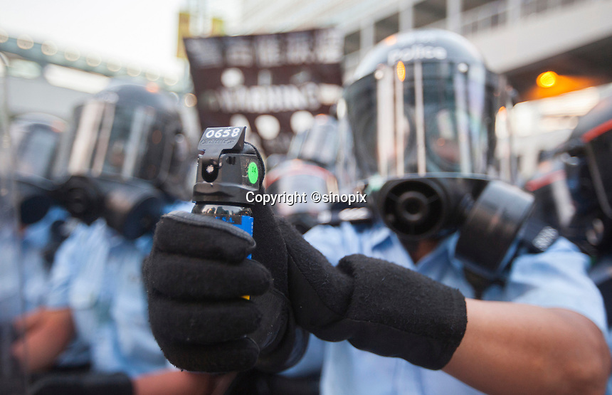 Hong Kong prepare to fire tear gas at pro-democracy protesters during the first day of the mass civil disobedience campaign Occupy Central, Hong Kong, China, 28 September 2014.