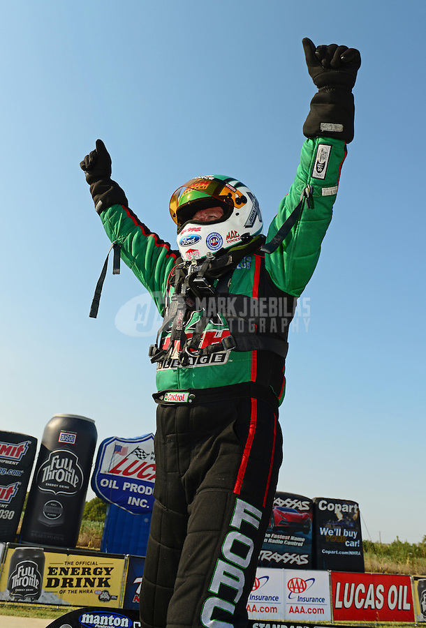 Sept. 22, 2012; Ennis, TX, USA: NHRA funny car driver John Force celebrates after winning the Traxxas Shootout during qualifying for the Fall Nationals at the Texas Motorplex. Mandatory Credit: Mark J. Rebilas-US PRESSWIRE