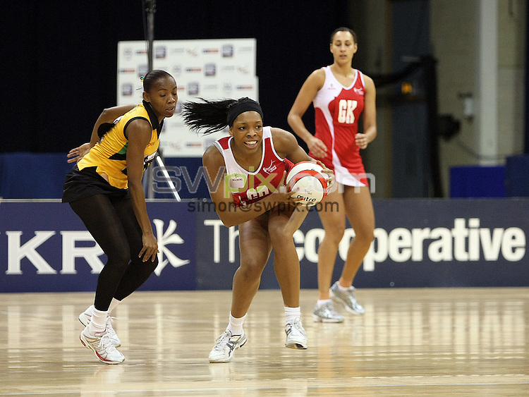 PICTURE BY VAUGHN RIDLEY/SWPIX.COM - Netball - The Co-Operative International Series - England v Jamaica, Third Test - Trent FM Arena, Nottingham, England - 26/02/09...Copyright - Simon Wilkinson - 07811267706...England's Eboni Beckford-Chambers wins the ball from Jamaica's Nadine Bryan.
