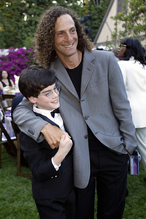 21 May 2005: 13 yr old jazz pianist Matt Savage and Kenny G at the 2nd Annual Gala Dinner benefiting the Chaka Khan Foundation in Beverly Hills, CA.  Matt was diagnosed with PDD, a form of autism at the age of 3, he taught himself to read piano music and began studying classical piano in 1998.  Matt performs worldwide helping to educate people about autism spectrum disorders..Mandatory Credit: Juliann Tallino/Icon SMI
