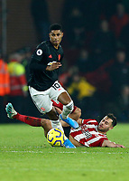 24th November 2019; Bramall Lane, Sheffield, Yorkshire, England; English Premier League Football, Sheffield United versus Manchester United; George Baldock of Sheffield United slides after he passes the ball with Marcus Rashford of Manchester United giving chase - Strictly Editorial Use Only. No use with unauthorized audio, video, data, fixture lists, club/league logos or 'live' services. Online in-match use limited to 120 images, no video emulation. No use in betting, games or single club/league/player publications