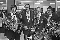 Part of the dutch water polo team back from Montreal,1976 Olympic Games.<br /> <br />  left to right: Buunk, trainer Trumbic, Smits and reserve keeper Boegschoten holding flowers<br /> Date July 30, 1976<br /> <br /> Photographer Verhoeff, Bert / Anefo