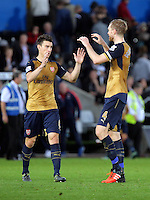 (L-R) Laurent Koscielny of Arsenal celebrates his team's win with team mate Per Mertesacker during the Barclays Premier League match between Swansea City and Arsenal at the Liberty Stadium, Swansea on October 31st 2015