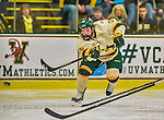 29 December 2013:  University of Vermont Catamount Forward Malcolm McKinney, a Freshman from West Vancouver, British Columbia, takes a shot in the second period against the Canisius College Golden Griffins at Gutterson Fieldhouse in Burlington, Vermont. The Catamounts defeated the Golden Griffins 6-2 to capture the 2013 Sheraton/TD Bank Catamount Cup NCAA Hockey Tournament for the second straight year. Mandatory Credit: Ed Wolfstein Photo *** RAW (NEF) Image File Available ***
