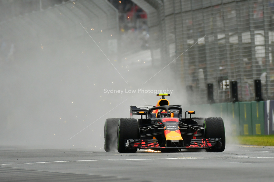 March 24, 2018: Max Verstappen (NLD) #33 from the Aston Martin Red Bull Racing team creates a rooster tail down the main straight during practice session three at the 2018 Australian Formula One Grand Prix at Albert Park, Melbourne, Australia. Photo Sydney Low