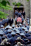 5/28/96<br /> Pallbearers carry the coffin of NJ State Trooper Francis J. Bellaran to a waiting hearse as many of his law enforcement brothers salute him for the last time.