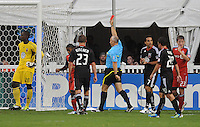 DC United goalkeeper Bill Hamid (28) gets a red card from referee Jasen Anno after a hard tackle in the 7th minute of the game. DC United tied Toronto FC 3-3 at RFK Stadium, Saturday August 6 , 2011.