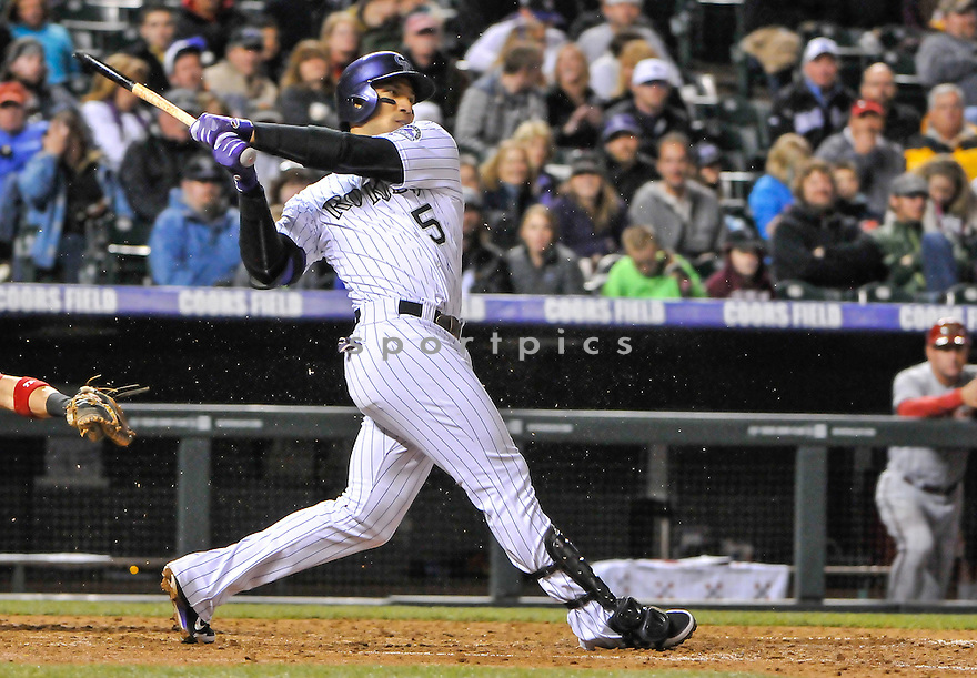Colorado Rockies Carlos Gonzalez (5) during a game against the Arizona Diamondbacks on April 20, 2013 at Coors Field in Denver, CO. The Rockies beat the Diamondbacks 4-3.