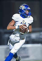 NWA Democrat-Gazette/CHARLIE KAIJO North Little Rock quarterback Kareame Cotton (4) looks for a receiver, Friday, November 29, 2019 during the Class 7A semifinal at Bentonville High School in Bentonville.
