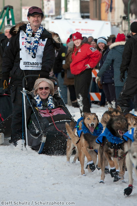 Allen Moore and team leave the ceremonial start line with an Iditarider at 4th Avenue and D Street in downtown Anchorage, Alaska on Saturday, March 5th during the 2016 Iditarod race. Photo by Joshua Borough/SchultzPhoto.com