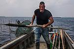 Venezia - Ivan Bognolo &egrave; parte di una delle pi&ugrave; vecchie famiglie di pescatori veneziani.<br /> Venice Ivan Bognolo moeche fisherman.
