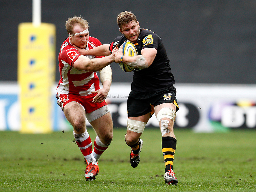 Photo: Richard Lane/Richard Lane Photography. Wasps v Gloucester Rugby. Aviva Premiership. 01/03/2015. Wasps' Thomas Young breaks from Gloucester's Matt Kvesic.
