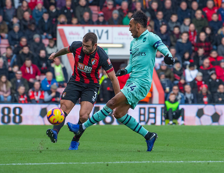 Bournemouth's Steve Cook (left) crosses the ball despite the attentions of  Arsenal's Pierre-Emerick Aubameyang (right) <br /> <br /> Photographer David Horton/CameraSport<br /> <br /> The Premier League - Bournemouth v Arsenal - Sunday 25th November 2018 - Vitality Stadium - Bournemouth<br /> <br /> World Copyright © 2018 CameraSport. All rights reserved. 43 Linden Ave. Countesthorpe. Leicester. England. LE8 5PG - Tel: +44 (0) 116 277 4147 - admin@camerasport.com - www.camerasport.com
