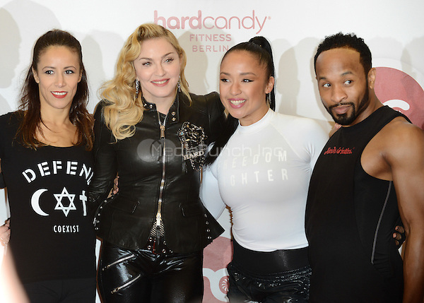 """Madonna, Nicole Winhoffer and the team members of the  fitness studio attending the """"Hard Candy Fitness"""" event in Berlin, Germany, 17.10.2013. Photo by Janne Tervonen/insight media /MediaPunch Inc. ***FOR USA ONLY***"""