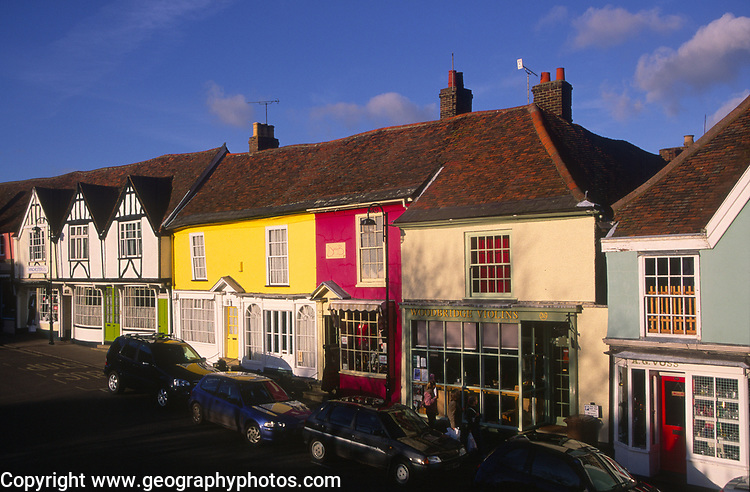 A3AAT1 Wooden framed colourful Tudor shop fronts Market Hill Woodbridge Suffolk