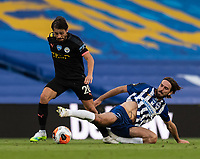 Manchester City's Bernardo Silva (left) is tackled by Brighton & Hove Albion's Davy Propper (right) <br /> <br /> Photographer David Horton/CameraSport<br /> <br /> The Premier League - Brighton & Hove Albion v Manchester City - Saturday 11th July 2020 - The Amex Stadium - Brighton<br /> <br /> World Copyright © 2020 CameraSport. All rights reserved. 43 Linden Ave. Countesthorpe. Leicester. England. LE8 5PG - Tel: +44 (0) 116 277 4147 - admin@camerasport.com - www.camerasport.com