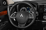 Car pictures of steering wheel view of  a 2015 Mitsubishi Outlander GT 4WD 5 Door SUV Steering Wheel