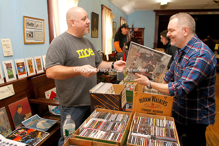 WOLCOTT, CT.- 01 MARCH 2014 - 030214JW03 - Vendor Andrew Lyman talks about his collection of music as Mike Mongillo of Meriden looks over a collection of Beastie Boys records Saturday morning during the Wolcott Grange's first records and music show. The dozen vendors on hand drew an approximate crowd of a hundred customers whose whose donations will benefit the Wolcott Grange.<br /> Jonathan Wilcox Republican-American