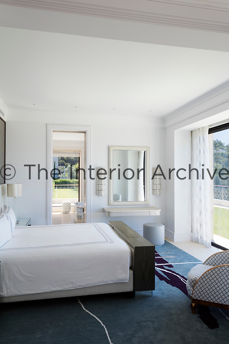 The bedroom is of a classic contemporary design scheme, which emphasizes pale muted colours and simple architectural forms.