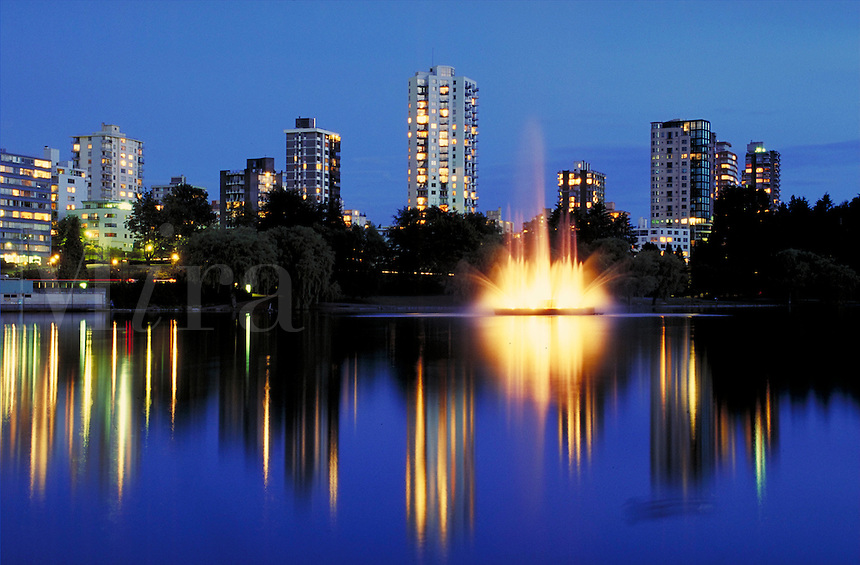 Illuminated fountain in Lost Lagoon, Stanley Park. City Center, city park, West End, downtown, night, calm, Canada Place, water, spray. Victoria British Columbia Canada Stanley Park.