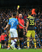 2nd November 2019; Etihad Stadium, Manchester, Lancashire, England; English Premier League Football, Manchester City versus Southampton; Jan Bednarek of Southampton is shown a yellow card by referee Lee Mason - Strictly Editorial Use Only. No use with unauthorized audio, video, data, fixture lists, club/league logos or 'live' services. Online in-match use limited to 120 images, no video emulation. No use in betting, games or single club/league/player publications