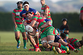 Petelo Richardson gets the ball away as he is tackled by Jason Guthrie. Counties Manukau Premier Club Rugby game between Waiuku and Ardmore Marist, played at Waiuku on Saturday June 4th 2016. Ardmore Marist won 46 - 3 after leading 39 - 3 at Halftime. Photo by Richard Spranger.