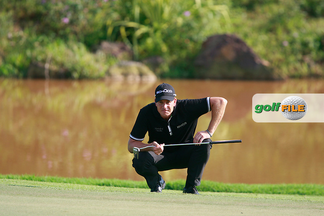 Henrik Stenson (SWE) lines up his putt on the 14th green during Saturday's storm delayed conclusion of Round 2 of the Iskandar Johor Open 2011 at the Horizon Hills Golf Resort Johor, Malaysia, 19th November 2011 (Photo Eoin Clarke/www.golffile.ie)