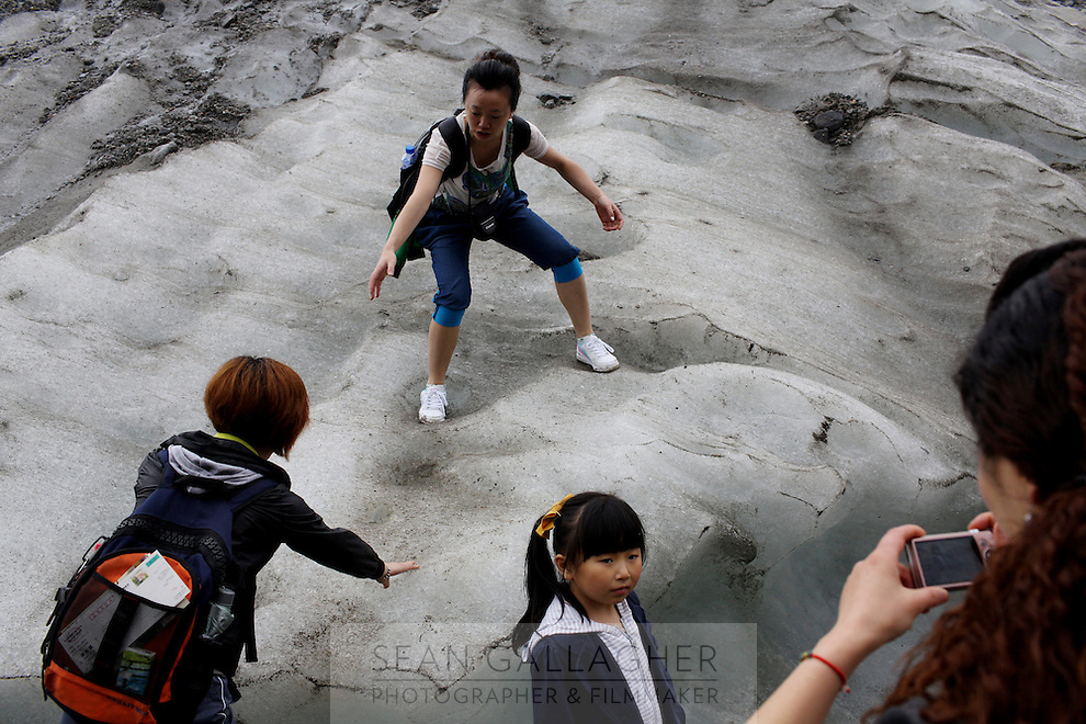 Tourists climbing on the Hailuogou glacier in western Sichuan Province, China. As a result of rising temperatures on the Tibetan Plateau, the Hailuogou glacier has retreated over 2 km during the 20th century alone. Since the Little Ice Age, studies have revealed that the total monsoonal glacier coverage in the southeast of the Tibetan Plateau has decreased by as much as 30 percent, causing alarm in scientific circles.