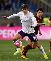 Calcio, Serie A: Roma vs Fiorentina. Roma, stadio Olimpico, 4 marzo 2016.<br /> Fiorentina&rsquo;s Marcos Alonso, left, is chased by Roma&rsquo;s Diego Perotti during the Italian Serie A football match between Roma and Fiorentina at Rome's Olympic stadium, 4 March 2016.<br /> UPDATE IMAGES PRESS/Riccardo De Luca