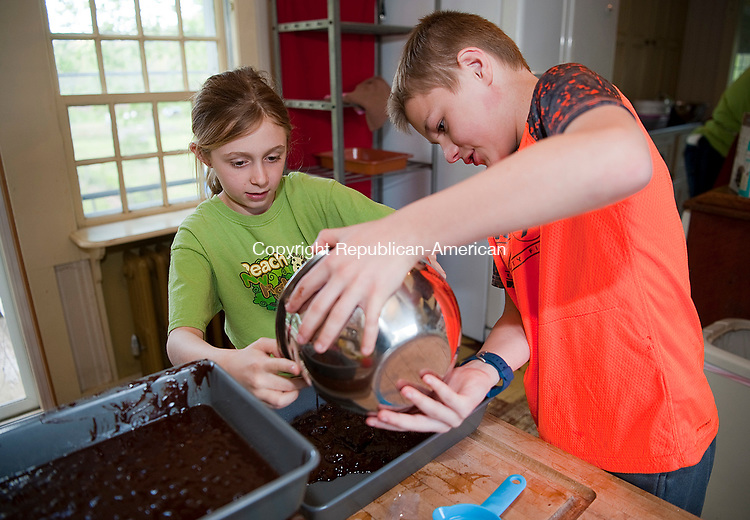 WOODBURY,  CT-051217JS02- Elizabeth Boistis, 8, of Middlebury and Zachary Johnson, 10, of Southbury, make brownies as they, and other children, learn to plan, prepare, cook and serve a healthy meal for their guest pattens, siblings, grandparents and friends Friday at the Van Vleck House at the Flanders Nature Center in Woodbury.  <br />  Jim Shannon Republican-American