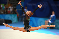August 22, 2008; Beijing, China; Rhythmic gymnast Natalya Godunko of Ukraine split leaps with clubs on way to eventually placing 7th in the All-Around final at 2008 Beijing Olympics..(©) Copyright 2008 Tom Theobald