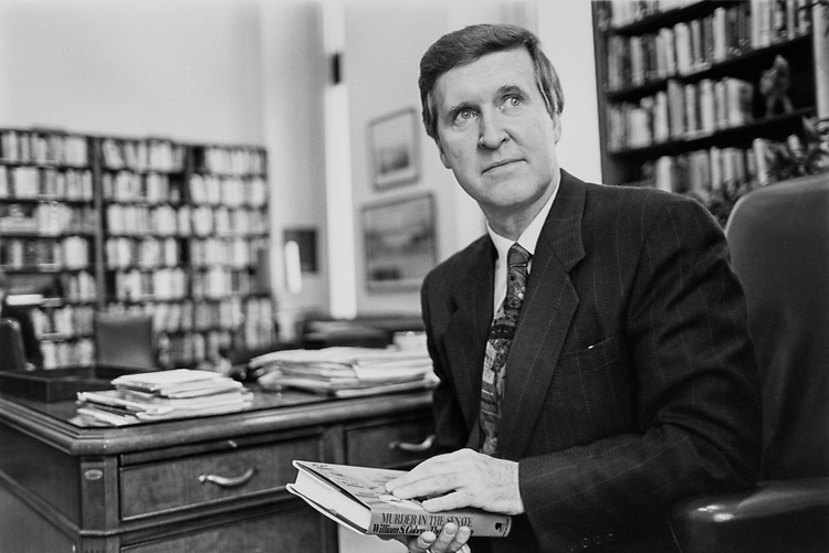 Sen. William Cohen, R-Maine., holding his most recent novel, 'Murder in the Senate', in January 1993. (Photo by Maureen Keating/CQ Roll Call via Getty Images)