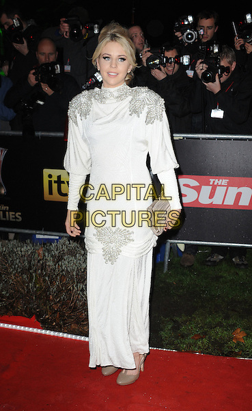 Lydia Bright.The Military Awards 2011 at the Imperial War Musuem, London, England..19th December 2011 .full length white dress silver shoulder pads clutch bag.CAP/WIZ.© Wizard/Capital Pictures.