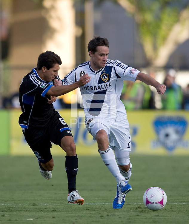 Todd Dunivant of Galaxy controls the ball away from Shea Salinas of Galaxy during the game at Buck Shaw Stadium in Santa Clara, California on October 21st, 2012.  San Jose Earthquakes and Los Angeles Galaxy tied at 2-2.
