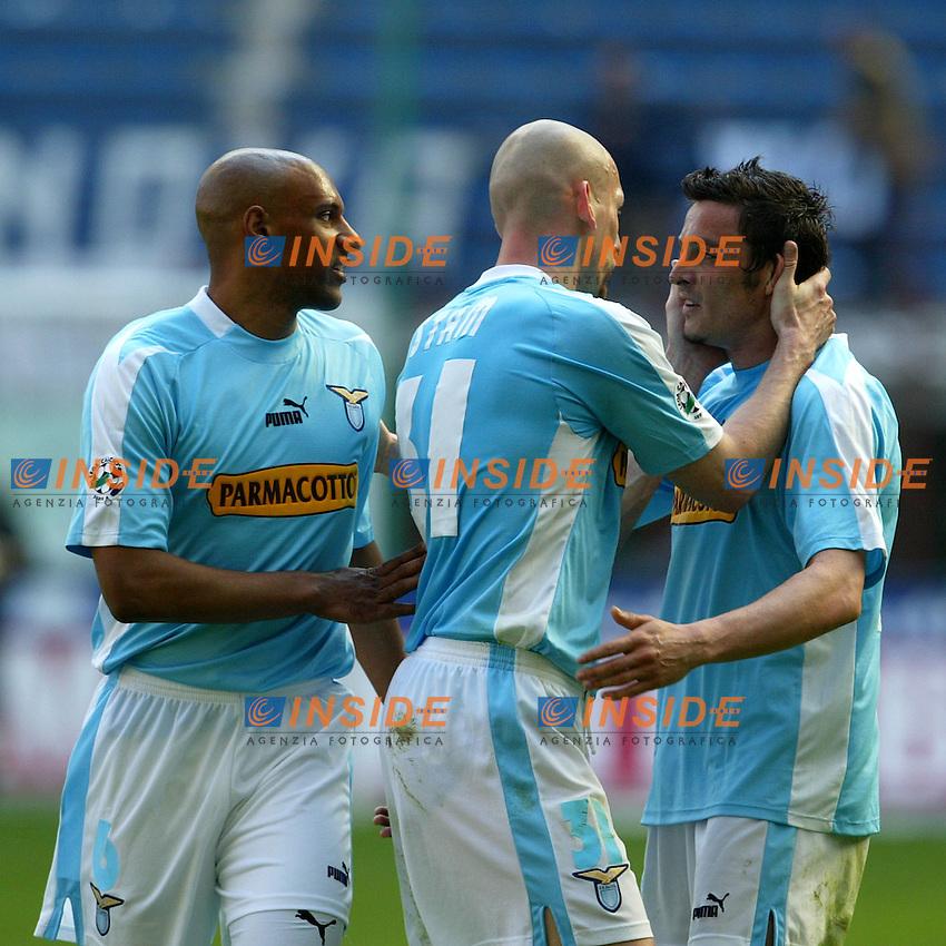 Milano 25/4/2004 Campionato Italiano Serie A - Matchday 31 <br /> Inter - Lazio 0-0 <br /> Ousmane Dabo, Jaap stam e Massimo Oddo a fine partita<br />  Photo Andrea Staccioli Insidefoto