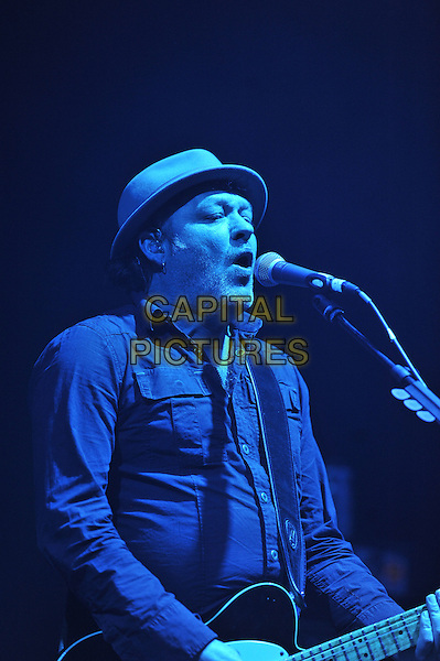 Mark Chadwick.Levellers performing live in concert, Brixton Academy, London, England. 18th December 2011.on stage gig performance music half length  singing hat   black shirt    .CAP/MAR.© Martin Harris/Capital Pictures.