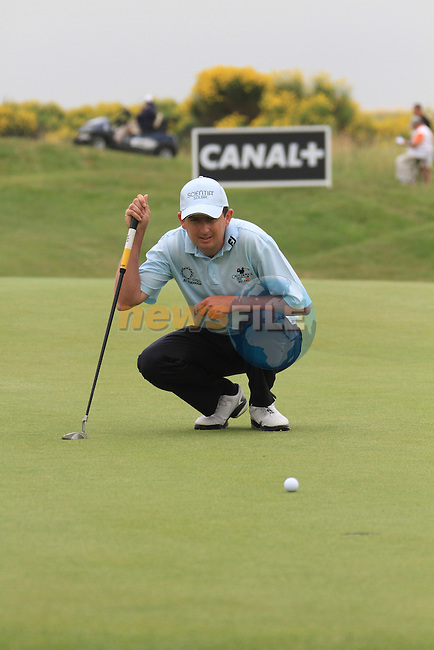 Peter Lawrie lines up his putt on the 9th on day three of the Alstom Open de France at .Golf National St Quentin en Yvelines, Paris France, 3/7/10.. Picture Fran Caffrey/www.newsfile.ie